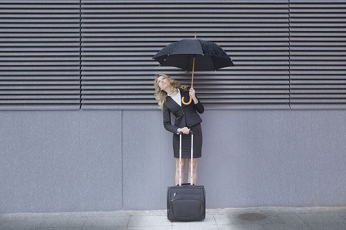 Holding Luggage On Rain